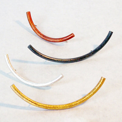 Long arc pins