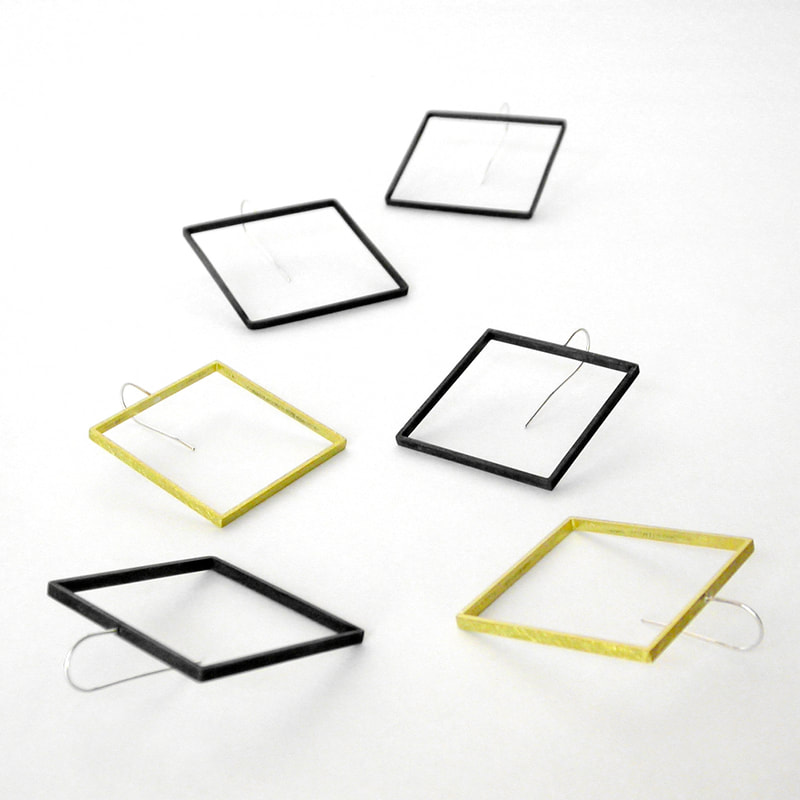 square slice earrings in black and yellow brass