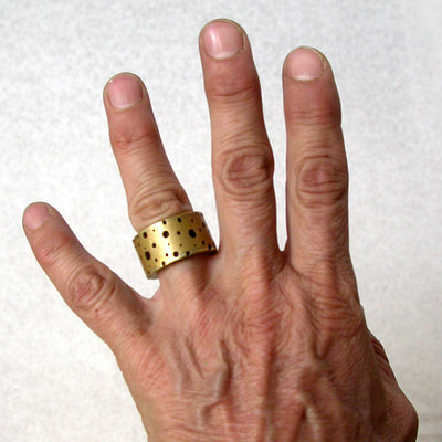 wide band brass Swiss Cheese ring